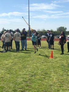 Special olympic athlete throwing javelin