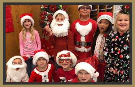 elementary students wearing Santa hats