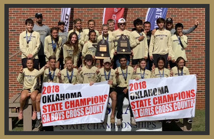Boys and Girls Cross Country teams holding 2018 Oklahoma State Champions 3A Boys and 2018 Oklahoma State Champions 3A Girls banners