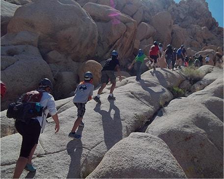 students climbing up rocks