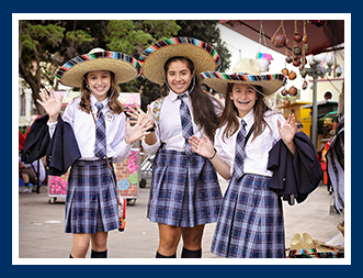 Three female students wear sombreros