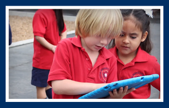 Students use tablets outside