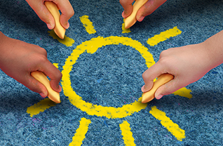 Students drawing a sun with chalk