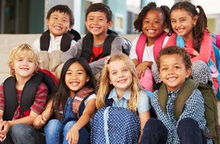 Students wearing backpacks pose together