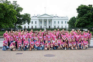 Students and teachers pose in front of the White House