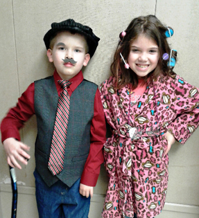 a boy and a girl dressed up as adults