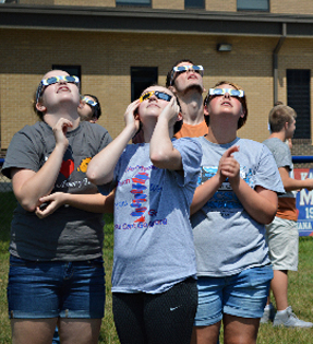 students with glasses on looking at the solar eclipses