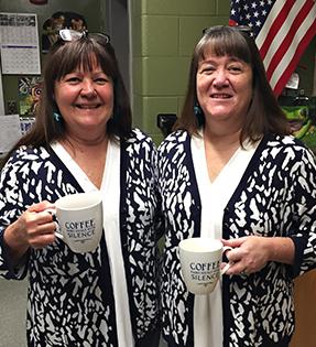 teachers wearing matching outfits holding coffee mugs