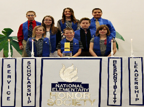 eight students with National Elementary Honor Society banner