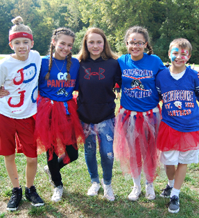 5 students dressed up in school colors on spirit day