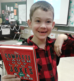 boy holding a joke book