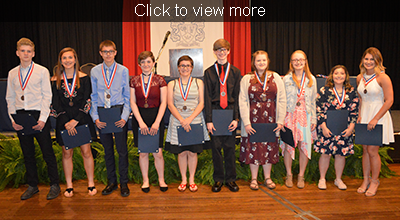 Click to view more. Top ten freshmen pose with their Academic Honors certificates and medals.