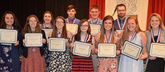 students at an Academic Honor Banquet with their awards