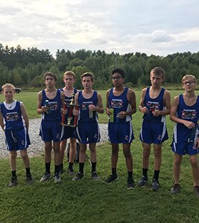 Boys cross country team outside on a course
