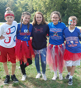 students dressed up in spirit gear with face paint