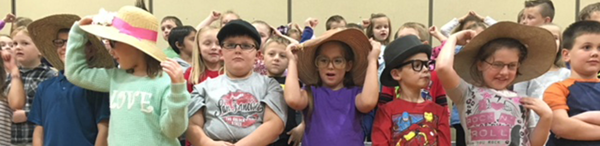 elementary students wearing hats