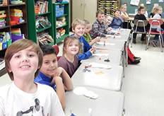 Students pose together at their desk