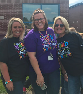Three smiling teachers - Trish Richey, Leah Lane, and Jen Downing