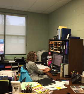 Mrs Cross in her office