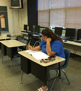 student at desk taking test