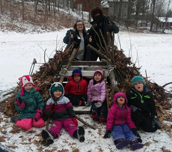 Pre-K students building beaver lodge with SCA members