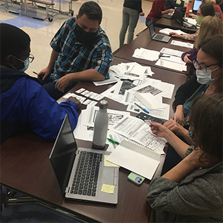 student tennis players heading to practice
