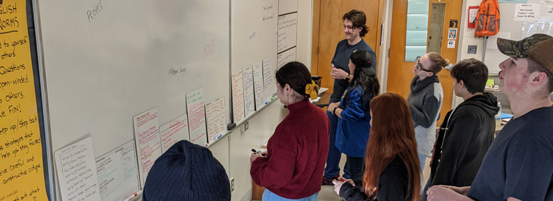 Students doing an activity on the whiteboard