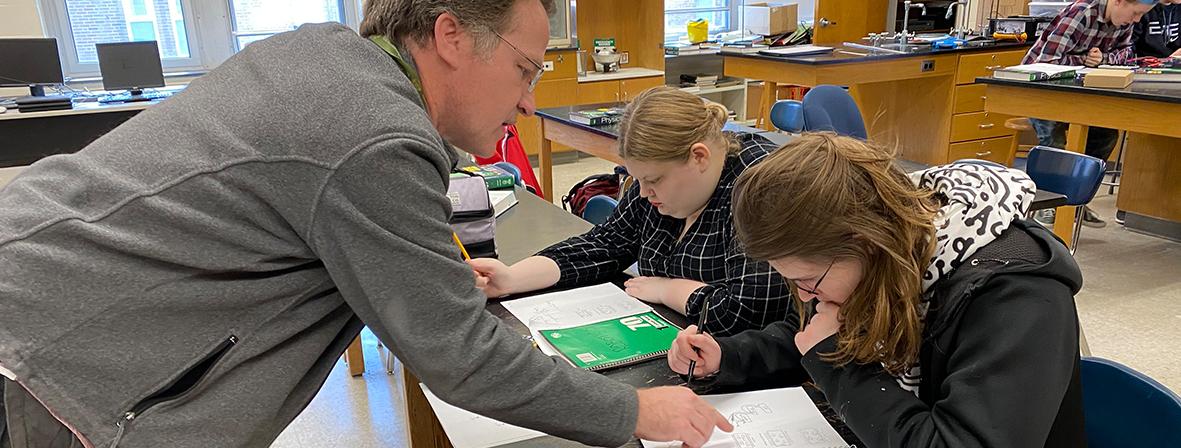 Teacher helping student during class