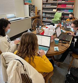 Middle School girls playing Field Hockey