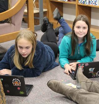 Two girls using laptops