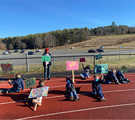 First graders outside with signs
