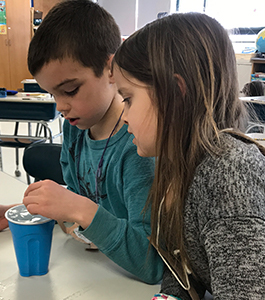 Students experimenting with water and ice