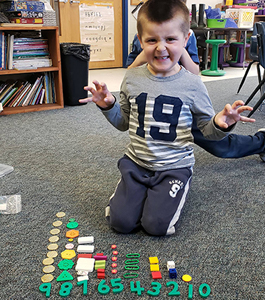 Boy working on counting items 1 through 9