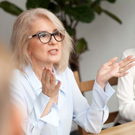 mature woman with glasses in a meeting