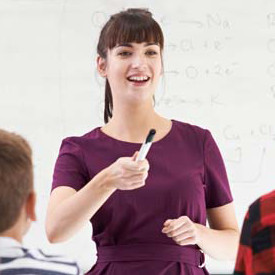 teacher pointing with a marker