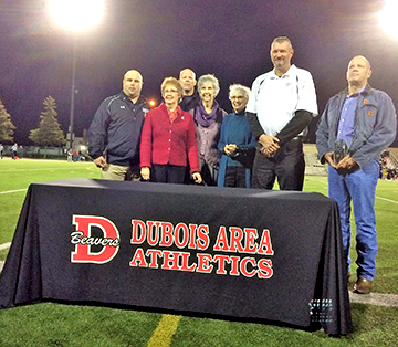 group of people standing on field at table that says DuBois Area Athletics