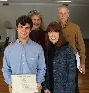 Carter Gee pictured with his parents and his teacher Martha Mills