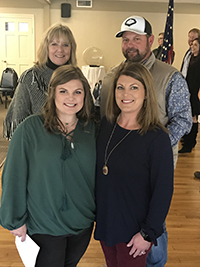 Mattie Sykes poses with her teacher Margaret Bouler and her parents Michael and Amy Sykes