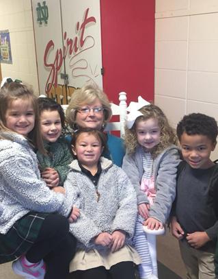 Students cluster around a teacher