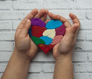 hands holding a puzzle heart