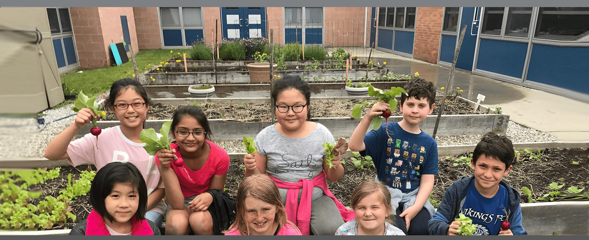 students holding radishes