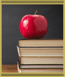red apple on stack of books