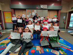 group of student holding their Hour of Code certificates.