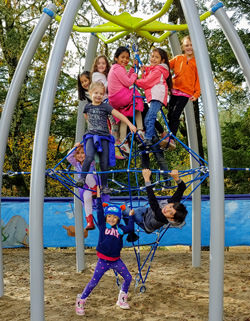Students playing on the new playground equipment