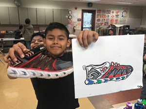 Student poses with his shoe self portrait