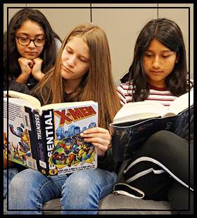 three students reading books