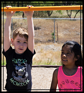 students playing on the monkey bars