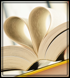 pages in a book folded to make a heart