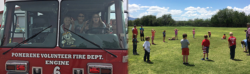 Students in a pomerene volunteer fire department firetruck and students on a field