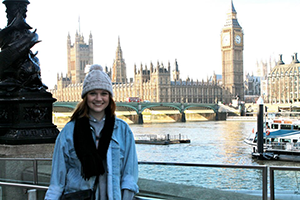 Laryssa Stahl poses in front of the river near Big Ben in London